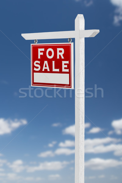 Left Facing For Sale Real Estate Sign on a Blue Sky with Clouds. Stock photo © feverpitch