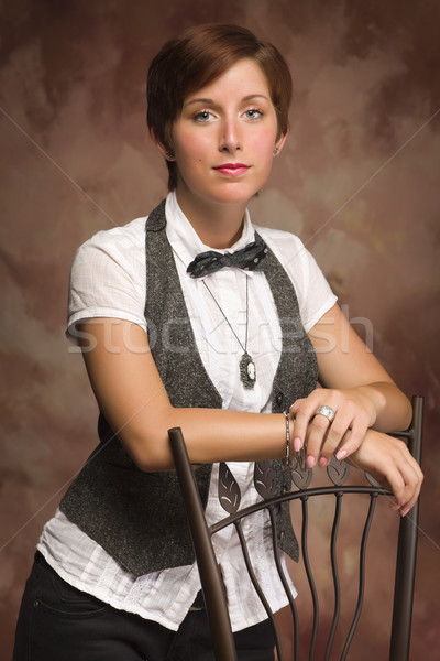 Attractive Red Haired Young Adult Female Portrait Leaning on Cha Stock photo © feverpitch