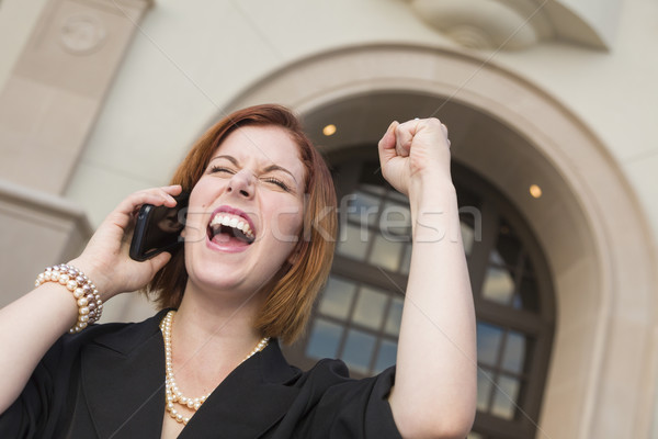 Young Businesswoman with Fist in Air On Cell Phone Stock photo © feverpitch
