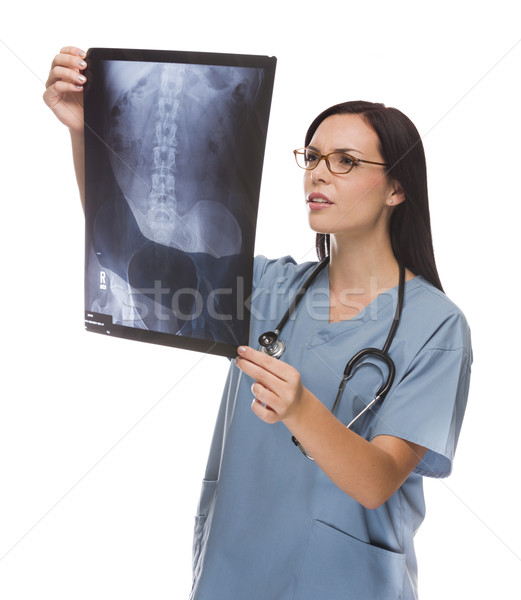 Mixed Race Female Doctor or Nurse Reviewing X-ray on White Stock photo © feverpitch