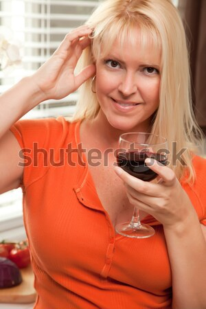 Blonde Socializing with Wine Glass Stock photo © feverpitch