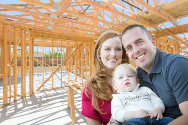 Young Military Family Inside The Framing of Their New Home at Co Stock photo © feverpitch