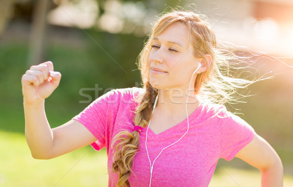 Young Fit Adult Woman Outdoors During Workout Listening To Music Stock photo © feverpitch