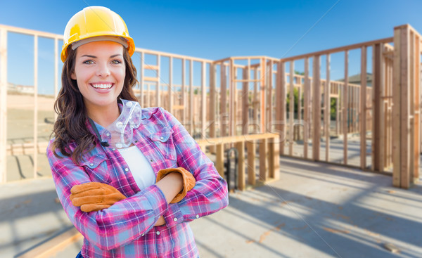 Young Attractive Female Construction Worker Wearing Gloves, Hard Stock photo © feverpitch
