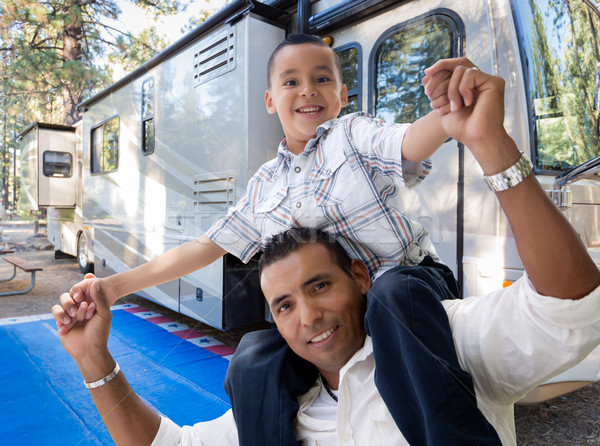 Happy Hispanic Father and Son In Front of Their Beautiful RV At  Stock photo © feverpitch