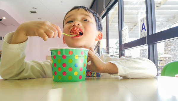 Cute Young Chinese and Caucasian Boy Enjoying Eating His Frozen  Stock photo © feverpitch