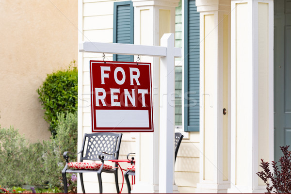 Red For Rent Real Estate Sign in Front House Stock photo © feverpitch