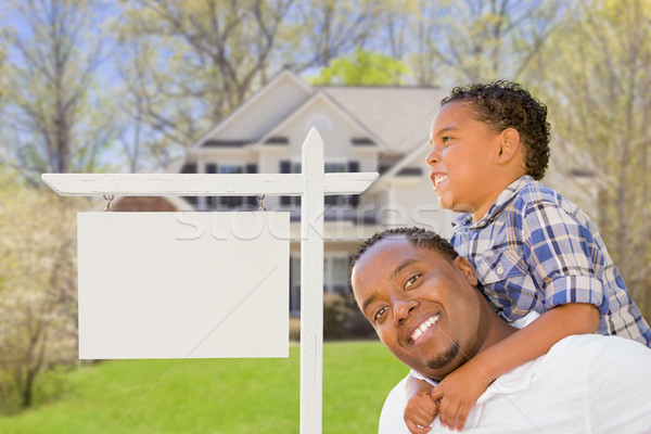 Father and Son In Front of Blank Real Estate Sign and House Stock photo © feverpitch