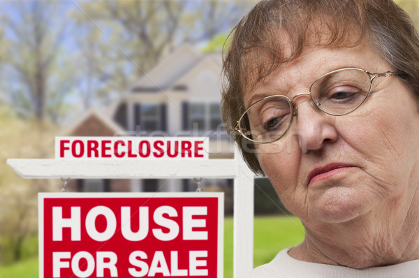 Depressed Senior Woman in Front of Foreclosure Real Estate Sign Stock photo © feverpitch
