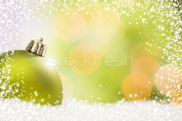 Green Christmas Ornament on Snow Over an Abstract Background Stock photo © feverpitch