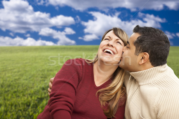 Happy Mixed Couple Sitting in Grass Field  Stock photo © feverpitch