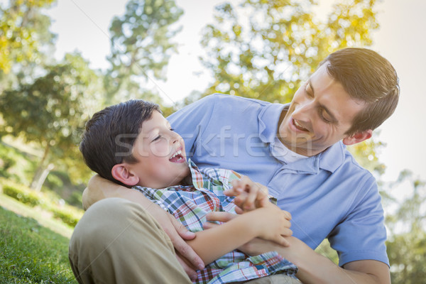 Loving Father Tickling Son in the Park Stock photo © feverpitch