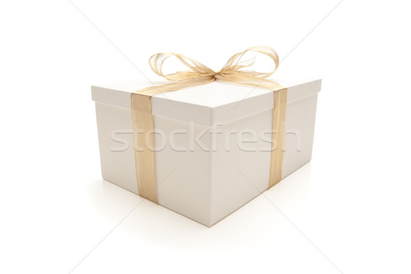 White Gift Box with Gold Ribbon Isolated Stock photo © feverpitch