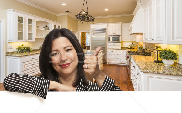 Hispanic Woman with Thumbs Up In Custom Kitchen Interior Stock photo © feverpitch