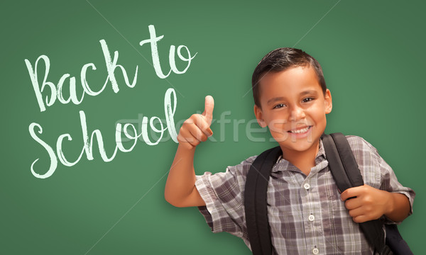 Thumbs Up Hispanic Boy in Front of Back To School Chalk Board Stock photo © feverpitch