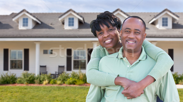 Happy African American Couple In Front of Beautiful House. Stock photo © feverpitch