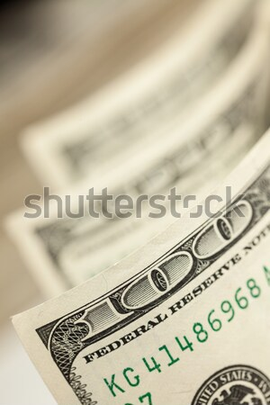 Roll of One Hundred Dollar Bills Tied Silver Bow on White Stock photo © feverpitch