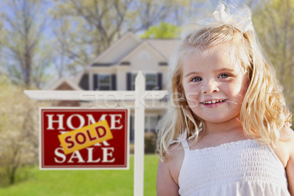 Cute Girl in Yard with Sold For Sale Real Estate Sign and House Stock photo © feverpitch