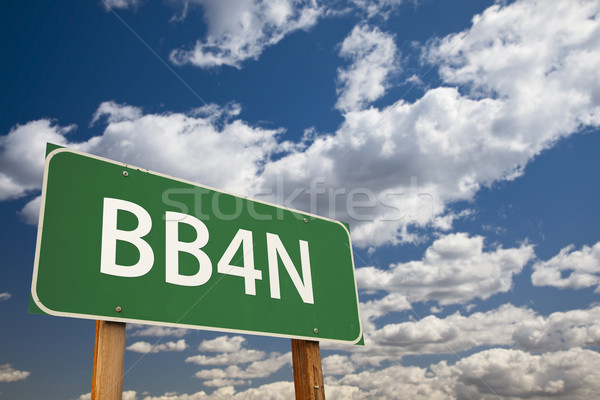 BB4N Green Road Sign Over Sky Stock photo © feverpitch