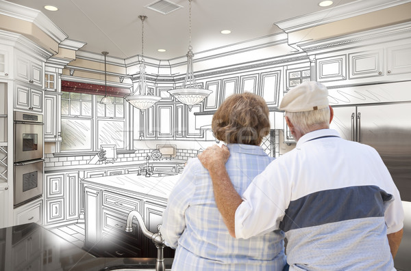 Senior Couple Looking Over Custom Kitchen Design Drawing and Pho Stock photo © feverpitch