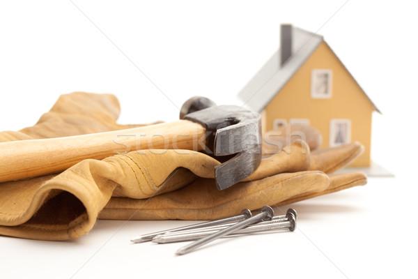 Marteau gants clous maison isolé blanche Photo stock © feverpitch