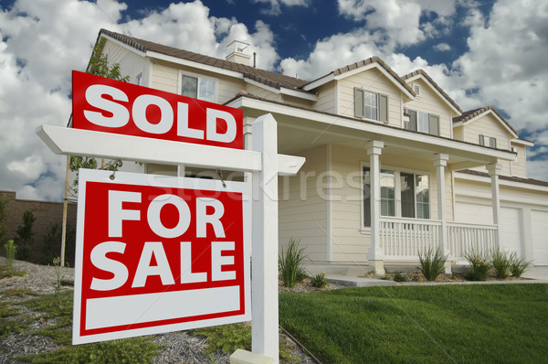 Sold Home For Sale Sign & New Home Stock photo © feverpitch