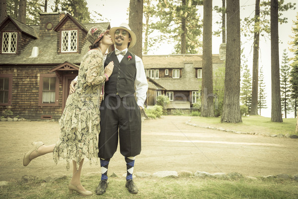1920s Dressed Romantic Couple in Front of Old Cabin Stock photo © feverpitch