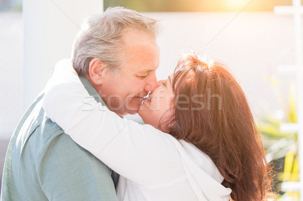 Middle Aged Couple Enjoy A Romantic Slow Dance and Kiss Outside Stock photo © feverpitch