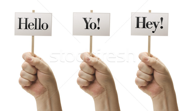 Three Signs In Fists Saying Hello, Yo! and Hey! Stock photo © feverpitch