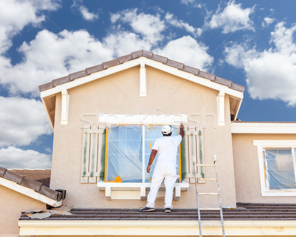 Professional House Painter Painting the Trim And Shutters of A H Stock photo © feverpitch