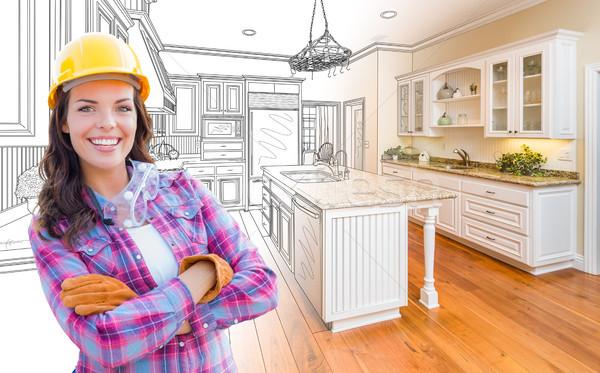 Vrouwelijke bouwvakker gewoonte keuken tekening afgewerkt Stockfoto © feverpitch