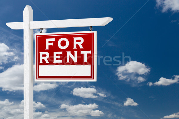 Right Facing For Rent Real Estate Sign Over Blue Sky and Clouds  Stock photo © feverpitch