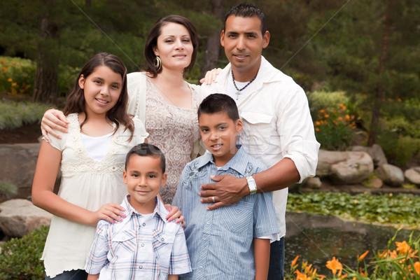 Feliz hispânico família parque retrato sorriso Foto stock © feverpitch