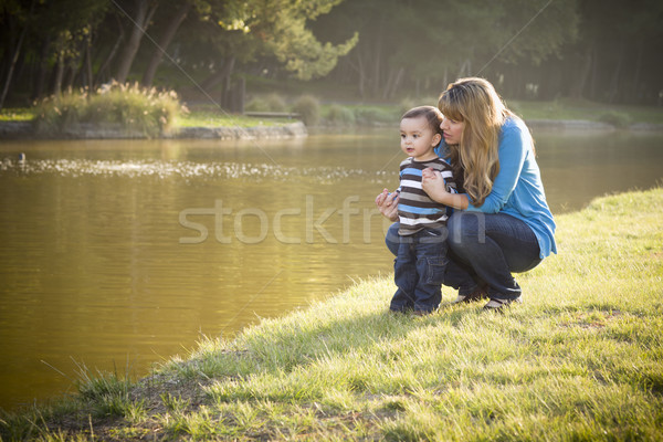Happy Mother and Baby Son Looking Out At Lake Stock photo © feverpitch