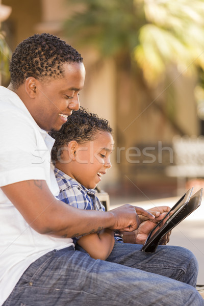 Mixed Race Father and Son Using Touch Pad Computer Tablet Stock photo © feverpitch