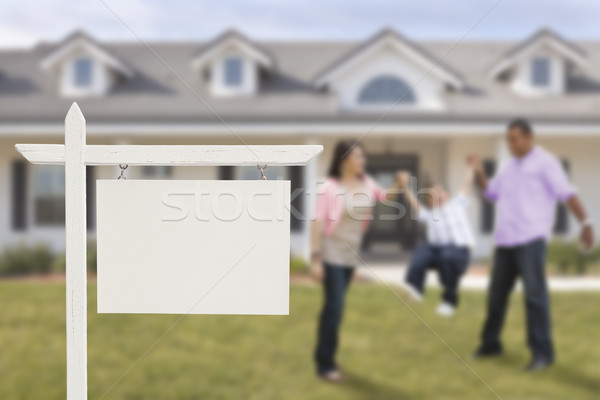 Stock photo: Blank Real Estate Sign and Hispanic Family in Front of House
