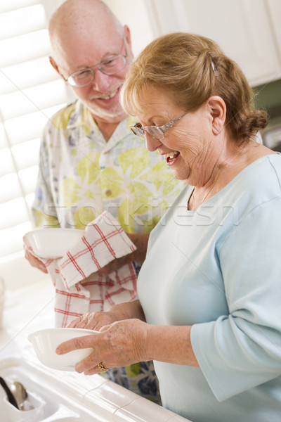 Senior Adult Couple Washing Dishes Together Inside Kitchen Stock photo © feverpitch
