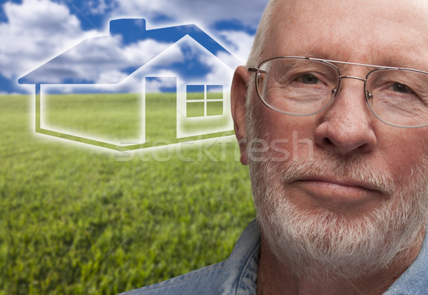 Stock photo: Melancholy Senior Man with Grass Field and Ghosted House Behind