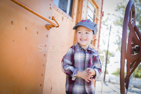 Cute Young Mixed Race Boy Having Fun on Railroad Car Stock photo © feverpitch
