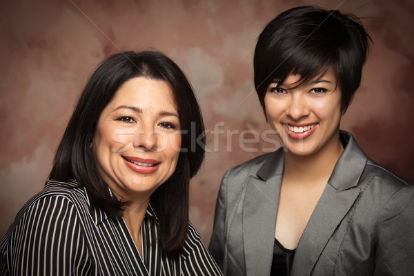 Attractive Multiethnic Mother and Daughter Studio Portrait Stock photo © feverpitch