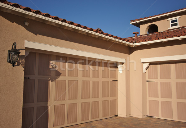 Abstract of newly constructed, modern home facade. Stock photo © feverpitch