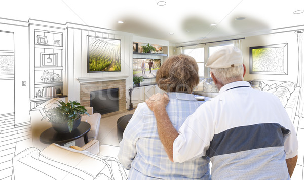 Senior Couple Looking Over Custom Living Room Design Drawing Pho Stock photo © feverpitch