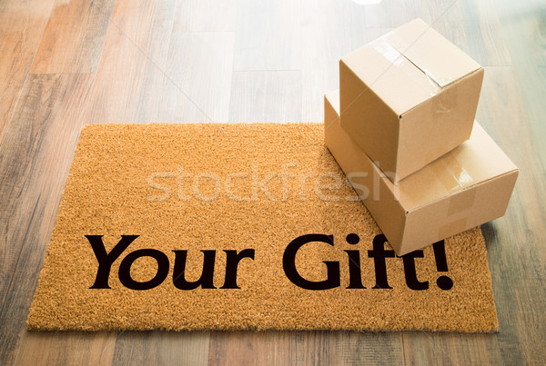 Your Gift Welcome Mat On Wood Floor With Shipment of Boxes Stock photo © feverpitch