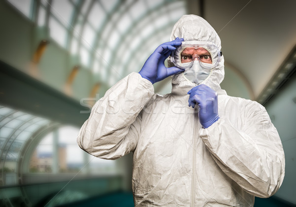 Man With Intense Expression Wearing HAZMAT Protective Clothing I Stock photo © feverpitch