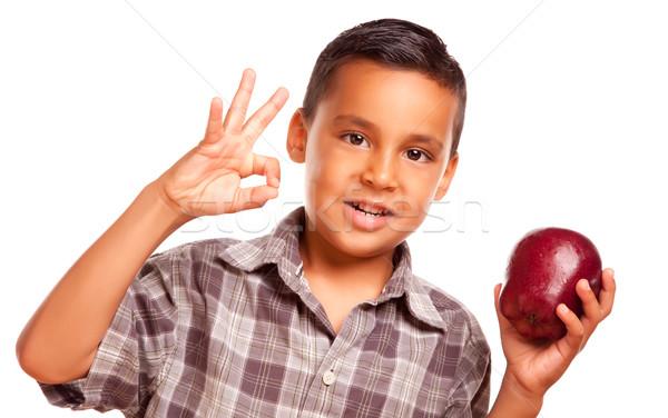 Adorable hispanique garçon pomme ok signe de la main Photo stock © feverpitch