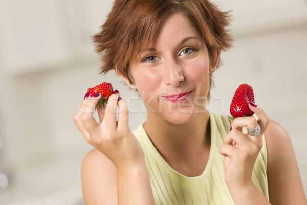 Pretty Red Haired Woman Eating Strawberry Stock photo © feverpitch
