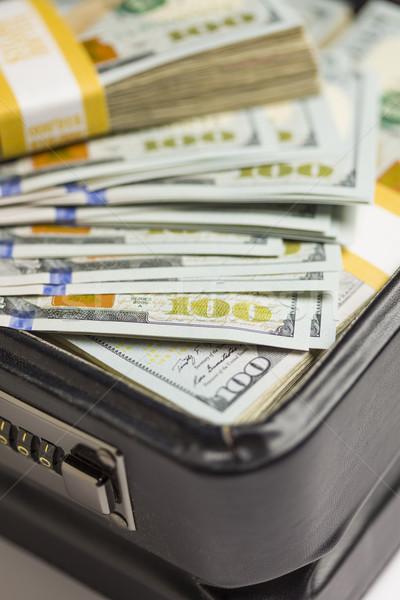újonnan egy száz dollár bankjegyek aktatáska absztrakt Stock fotó © feverpitch