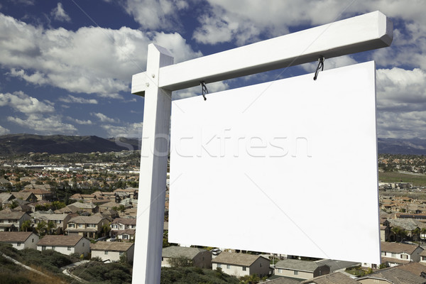 Blank Real Estate Sign Over Elevated Housing Community View Stock photo © feverpitch