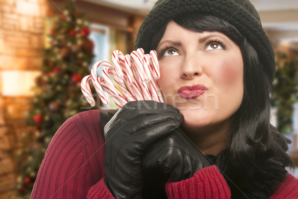 Stock photo: Woman Holding Candy Canes in Christmas Setting