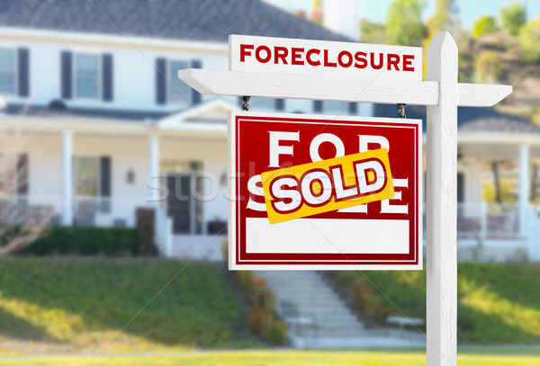 Left Facing Foreclosure Sold For Sale Real Estate Sign in Front  Stock photo © feverpitch